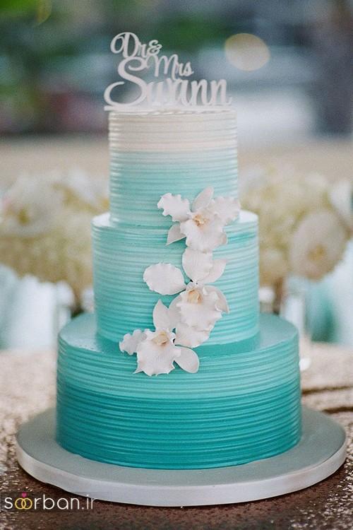 کیک عروسی با روکش خامه با رنگ سبزآبی