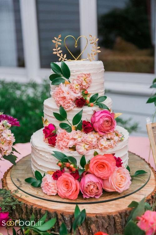 عکس مدل کیک عروسی با روکش خامه و گل های شاد و زیبا