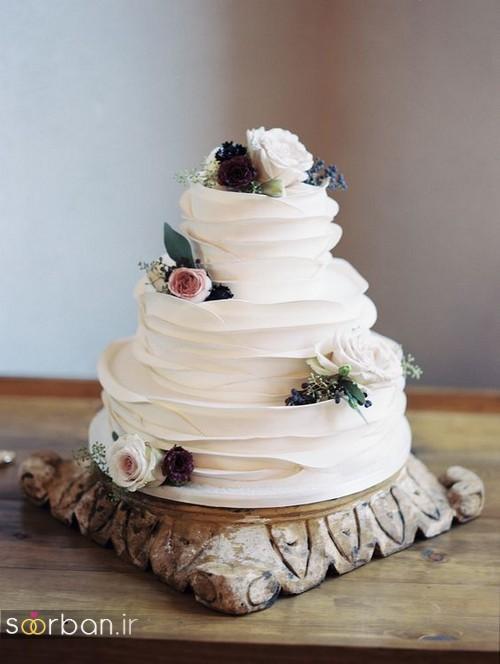 عکس کیک عروسی با روکش خامه و گل