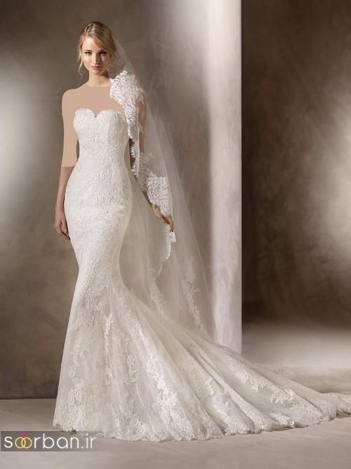 لباس عروس با تور دانتل بسیار زیبا و دنباله دار دکلته مدل ماهی
