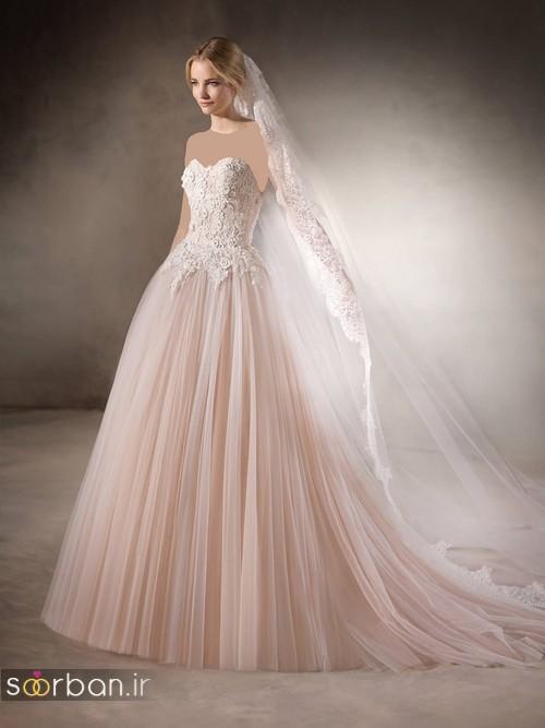 عکس مدل لباس عروس با تور دانتل کرم صورتی چین دار و دنباله دار