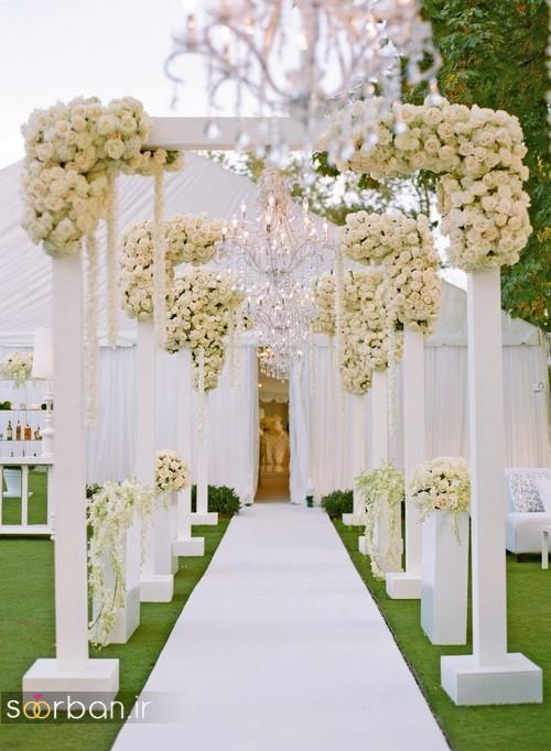 تزیین ژورنالی ورودی باغ تالار عروسی با دسته گل