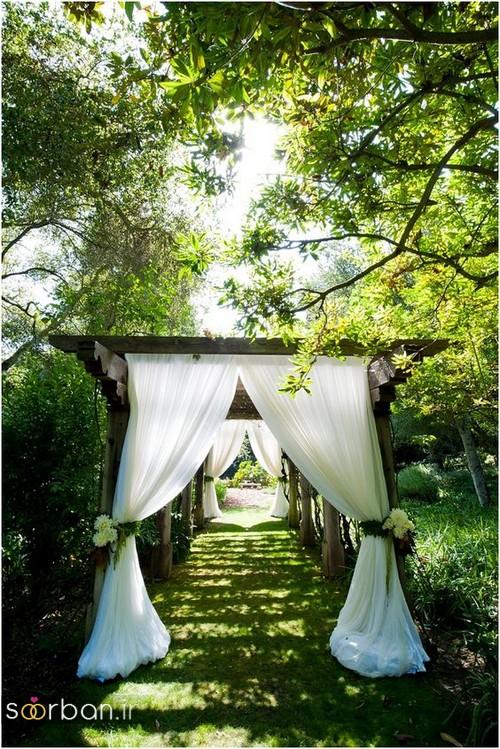 عکس مدل تزیین ژورنالی ورودی باغ تالار عروسی با قاب و پرده