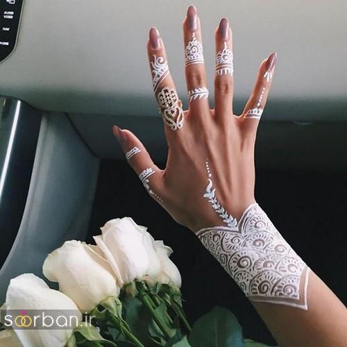 عکس مدل طراحی شیک با حنا سفید روی دست عروس