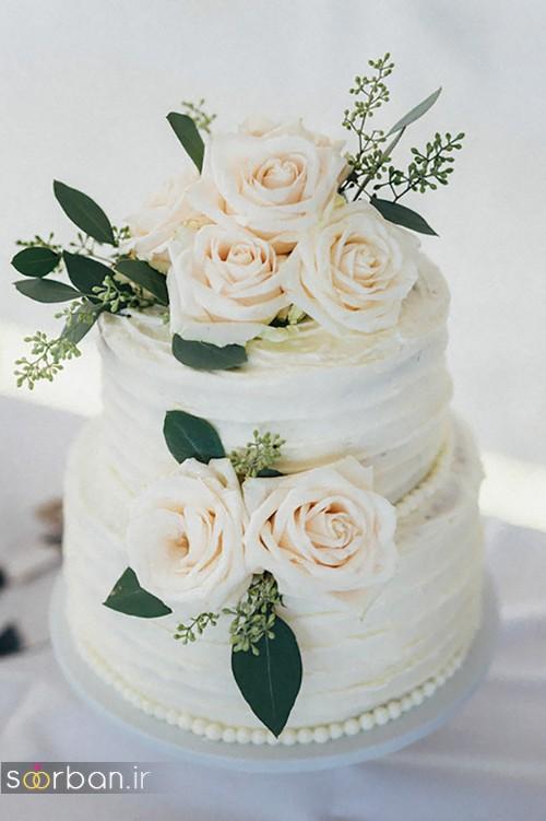 مدل کیک عروسی با روکش خامه با بند مروارید